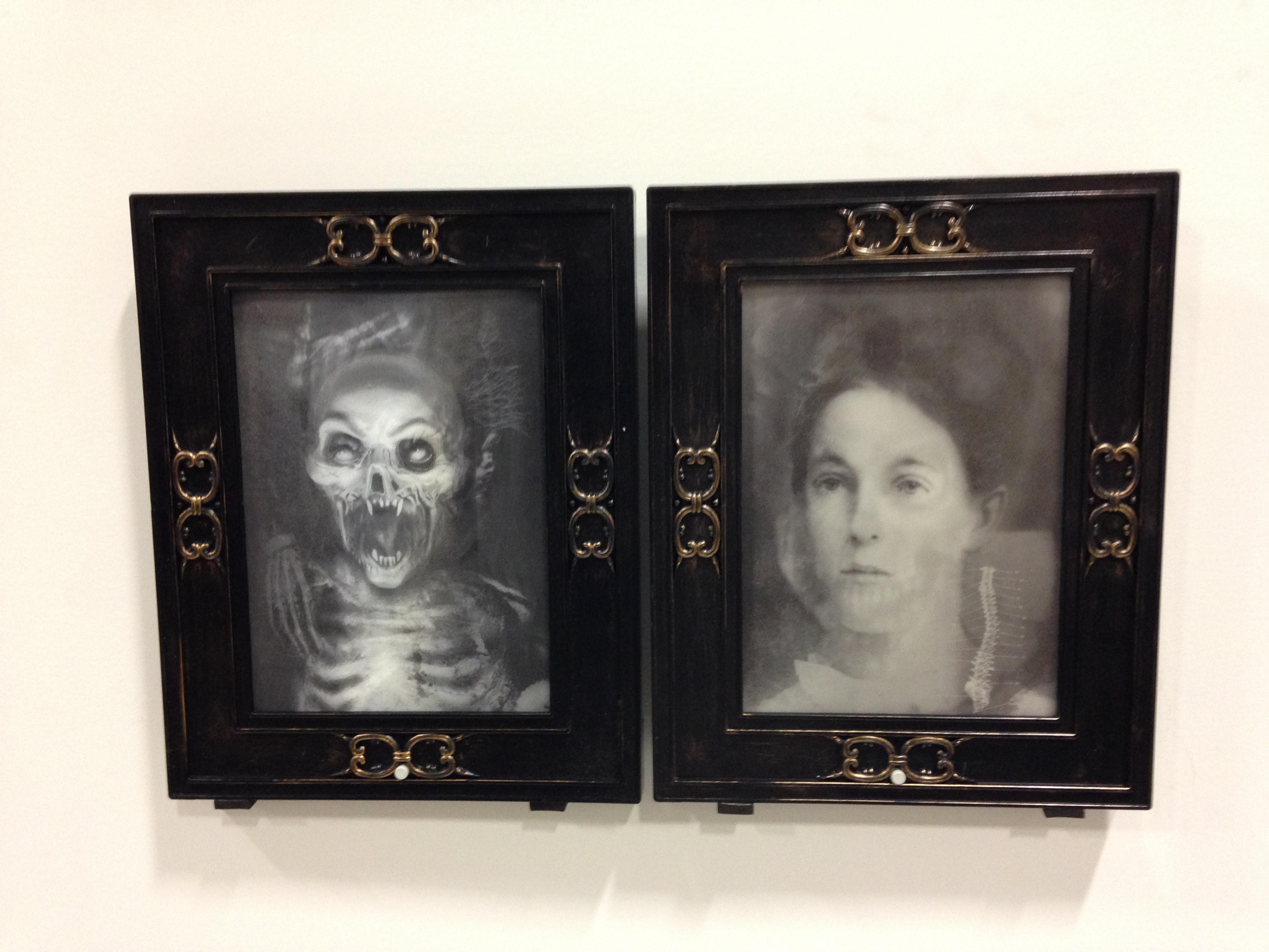pair of framed hologram heads